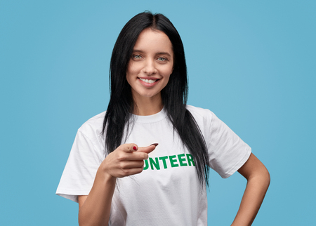 Confident volunteer pointing at camera