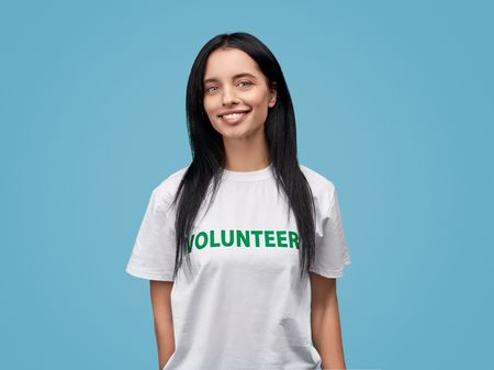 Smiling female volunteer looking at camera
