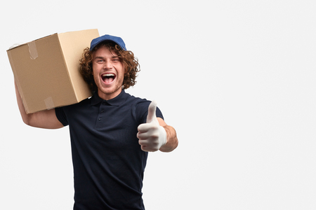 Excited delivery man gesturing thumb up