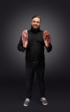 Stylish butcher posing with meat Stock Photo - 119617104