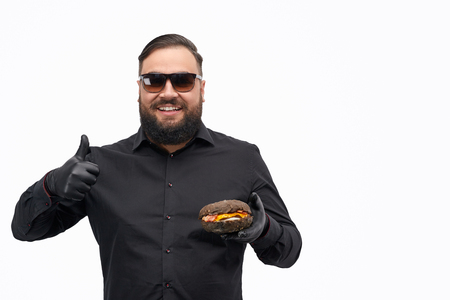 Overweight guy approving burger