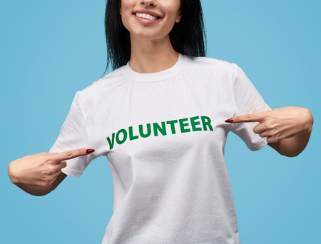 Crop volunteer pointing at T-shirt