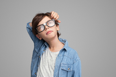 Thoughtful boy looking up Banco de Imagens