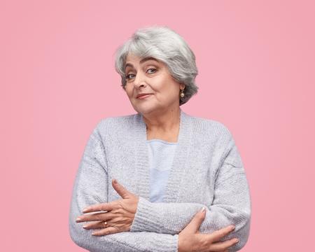 Unsure elderly woman looking at camera Standard-Bild - 120951870