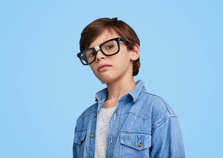 Little smart boy in broken glasses Banco de Imagens