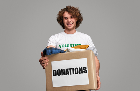 Smiling volunteer with donations box