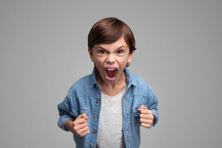 Angry boy screaming at camera Banco de Imagens