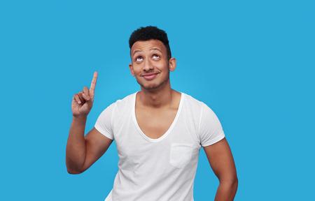 Charming black guy pointing up 版權商用圖片