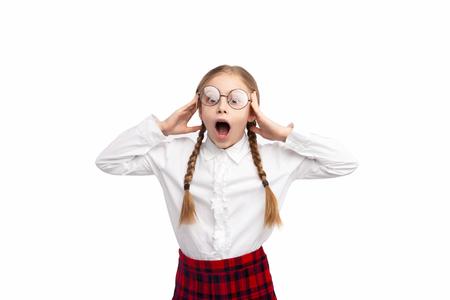 Shocked schoolgirl in uniform screaming
