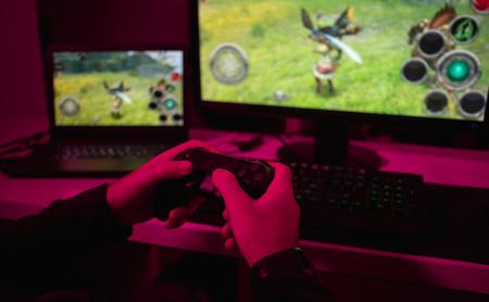 Crop hands playing online game Reklamní fotografie