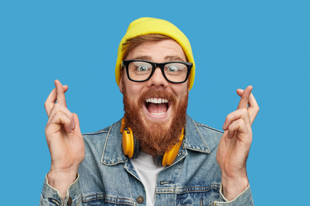 Excited hipster wishing to win lottery Stockfoto