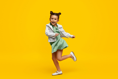 Stylish child smiling and dancing Stockfoto - 121479893