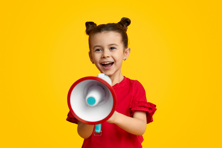 Cheerful girl with speaker