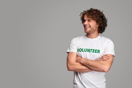 Confident volunteer looking away