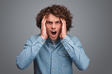 Young man screaming in shock Stock Photo