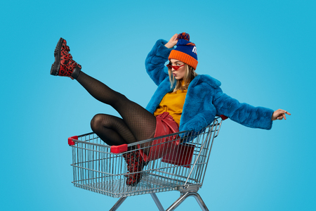 Fashionable woman in shopping cart