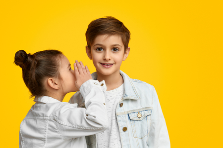 Girl sharing secrets with friend Stock Photo