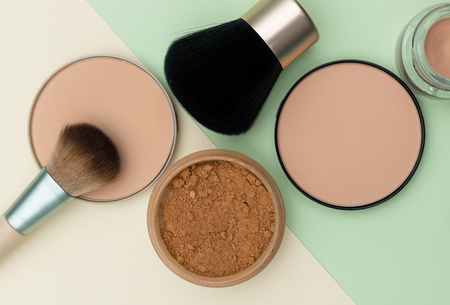 Compact face powder and brushes