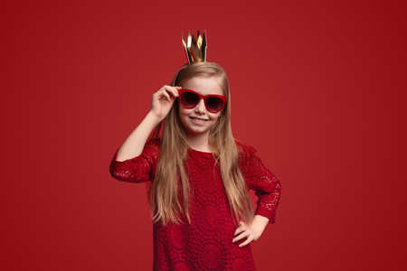 Little princess adjusting sunglasses