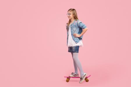 Little kid riding skateboard