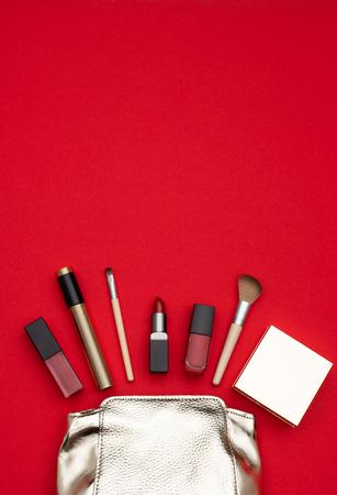 Makeup supplies near shiny bag 스톡 콘텐츠