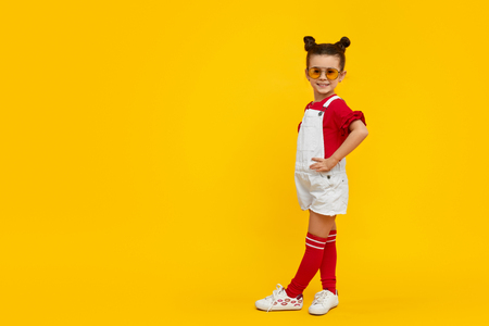 Trendy kid model posing for camera 写真素材