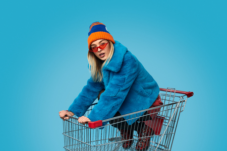 Crazy female in shopping cart