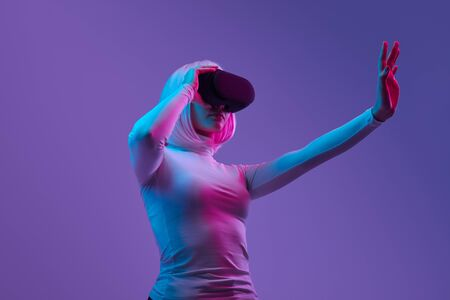 Futuristic woman interacting with virtual reality