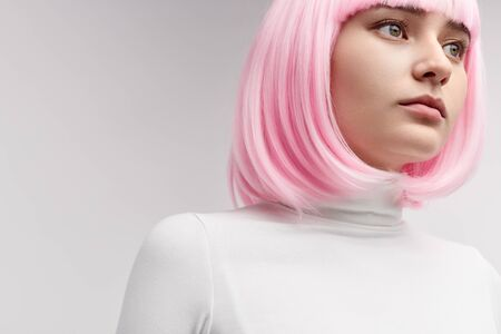 Female robot in pink wig looking away Stock fotó - 125499563