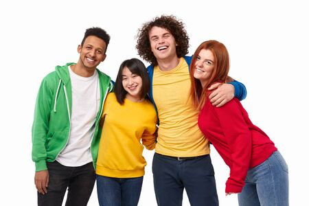 Multiracial friends smiling and hugging