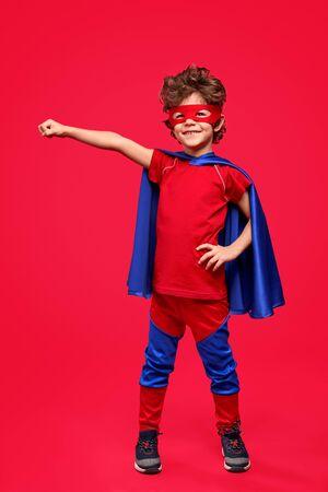 Cheerful superhero in heroic pose