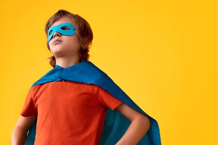 Confident superhero looking away