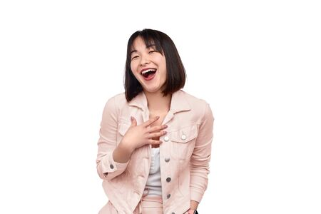 Young Asian female laughing out loud