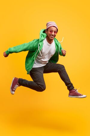 Funny black guy smiling and jumping Standard-Bild