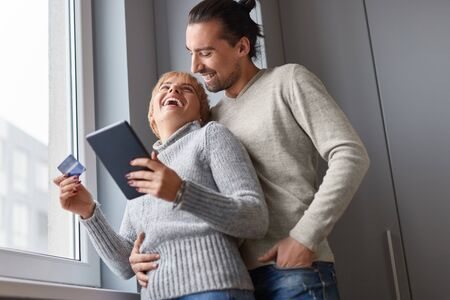 Happy couple making online purchases