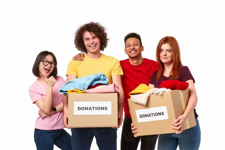 Happy diverse volunteers with donations
