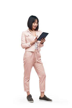 Asian lady browsing tablet Reklamní fotografie