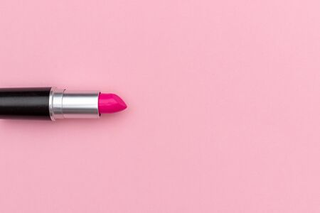 Vibrant magenta lipstick near empty space