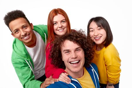Multiracial friends taking selfie together 版權商用圖片