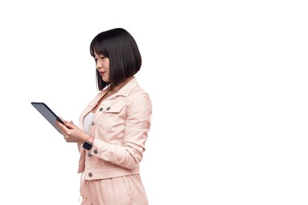 Elegant Asian lady browsing tablet