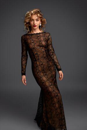 Sensual female in long evening dress Reklamní fotografie