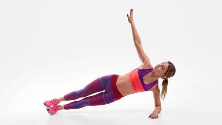 Female athlete doing side plank