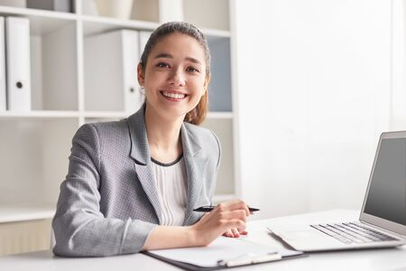Cheerful office worker with clipboard