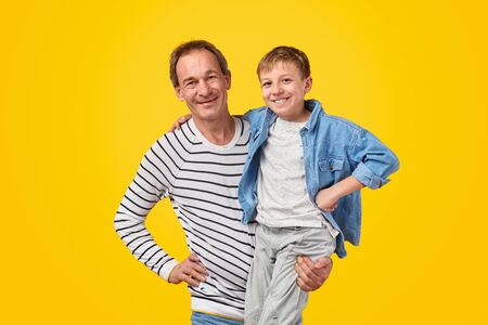 Happy grandfather with cheerful boy Stock Photo
