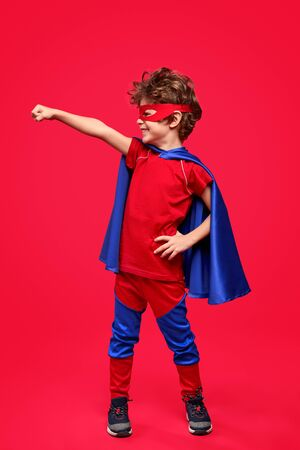 Courageous superhero looking away Stock Photo