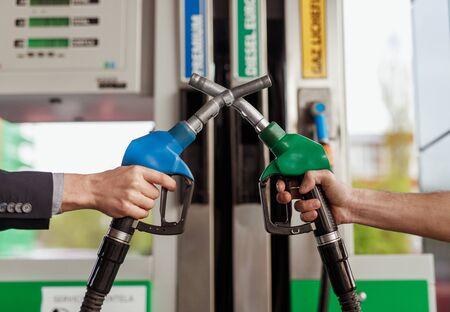 Crop hands crossing fuel nozzles