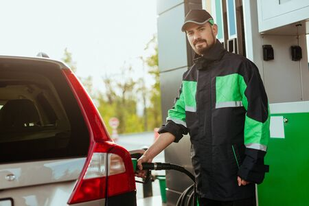 Gas station worker looking at camera