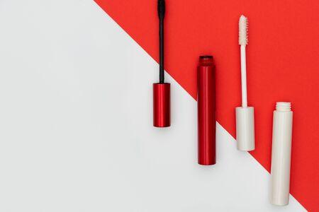 Tubes and brushes of professional mascara Stock Photo - 128957740