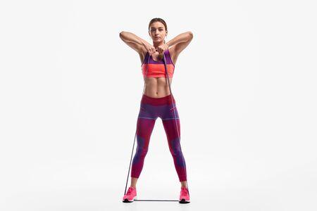 Fit female pulling elastic band