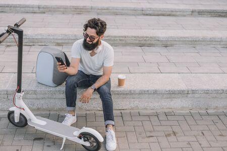 Stylish man using smartphone on city street Stock fotó